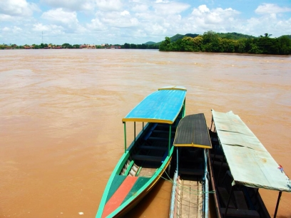 LAOS: These bad boys took us down the Mekong to the Four Thousand Islands. Our first time on the brown river.