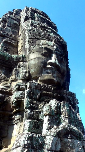 CAMBODIA: Face in the rock from the Bayon Temple at Angkor. Hello!
