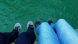 NEW ZEALAND: Our feet dangling over Tolaga Bay Wharf - the longest concrete wharf in the Southern Hemisphere.