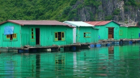 VIETNAM: Floating Fishing Village in Halong Bay. The water is almost the same colour as the houses.