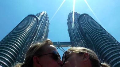 MALAYSIA: Smoochin' in front of the Petronas Towers in Kuala Lumpur. Probably illegal.