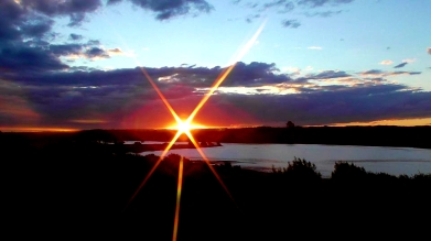 NEW ZEALAND: Sunset over Lake Aniwhenua after eating traditional Hangi food (cooked underground). Tasted as good as the view looked!