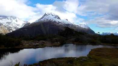 NEW ZEALAND: An alpine lake surrounded by mountains on the Routeburn Track.