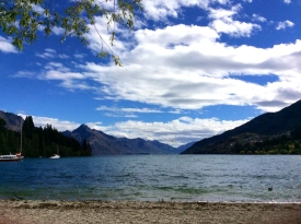NEW ZEALAND: Queenstown lake by day. Perfect place to paddle board/kayak, or as we did - eat a pie.