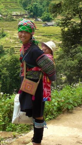 VIETNAM: Hilltribe momma on our trek in Sapa. Yes, she carried the baby the whole time, while we struggled carrying our water bottles.