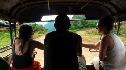 LAOS: There's no better way to travel, than with friends in a tuk tuk.